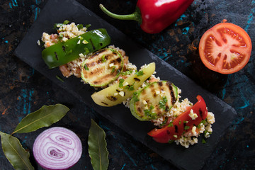 Grilled red, green and yellow peppers