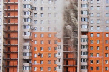 Russia, Saint-Petersburg - 28 march. High-rise condominium or apartment burning. Fire in apartments of a large tenement-house. Fire on several floors, the smoke comes out of the windows.