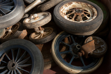 Used wheels from wheelbarrows for transportation of domestic cargo