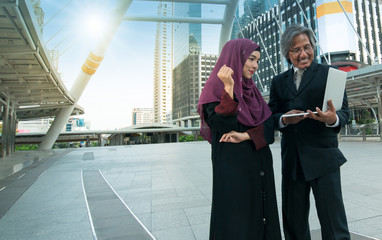 Two Muslim men and women businessmen