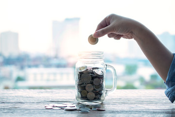 Collection coins it the jar saving concept.