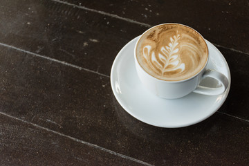 Cup of latte or cappuccino on the table in cafe