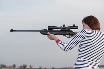 Portrait of middle aged woman with rifle