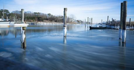 Montauk, USA - circa January 2018: icy watter at a little port on Long Island