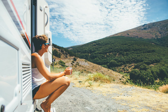 Girl sits on a motor home step