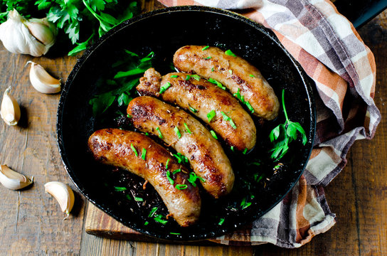 Homemade sausages from turkey (chicken) fried in a frying pan