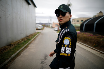 A South Korean soldier leads, in the Tae Sung freedom village near the Military Demarcation Line (MDL), in Paju