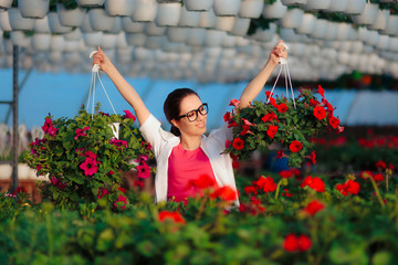 Happy Female Horticulture Scientist Holding Two Flower Pots Wall mural