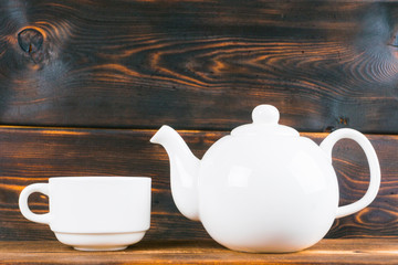 tea cup and pot on rustic wooden table