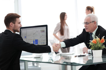 businessman welcomes business partner shaking hands