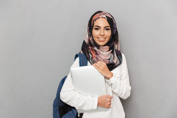 Portrait of a smiling young arabian woman student