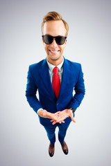 Portrait of young businessman in sunglasses