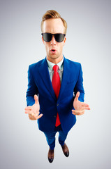 Funny young businessman in sunglasses