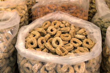 Taralli, traditional italian snack on sale in outdoor market in Southern Italy.