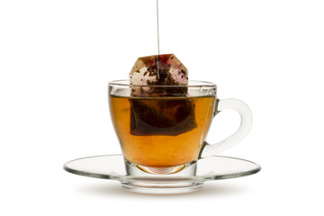 tea in glass cup with tea bag, on white background