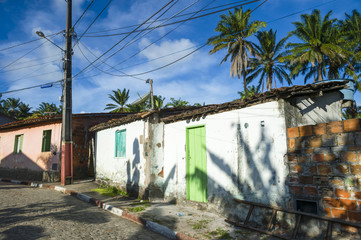 Simple Brazilian countryside village with abandoned buildings on a cobbled road in Bahia, Brazil