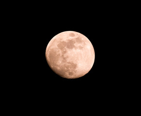 Red moon on a black background at night