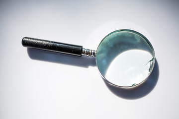Old magnifying glass isolated on white background, Light and Shadow