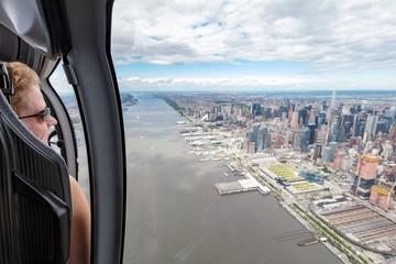 Helicopter passenger overlooking New York midtown