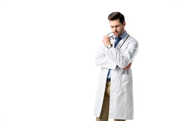 Thoughtful doctor wearing white coat with stethoscope isolated on white