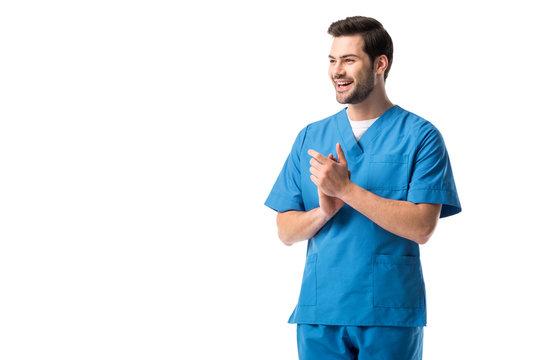 Smiling male nurse wearing blue uniform isolated on white