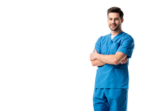 Male nurse wearing blue uniform standing with folded arms isolated on white