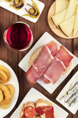 Spanish food. Overhead photo of different tapas with wine