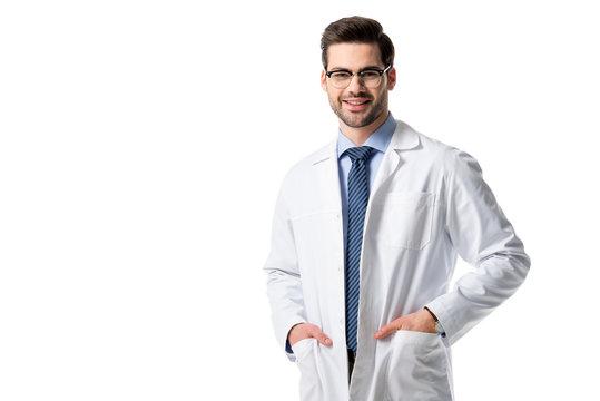 Smiling doctor wearing white coat isolated on white