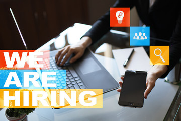 We are hiring text on virtual screen. Recruitment. HR. Human resources management. Business concept.