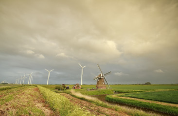 old and modern windmills in Dutch countryside
