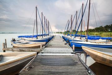 yachts and boats at pier on big lake