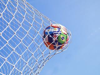Soccer ball flying to goal