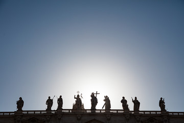 Silhouette of St. Peter's statues at sunset