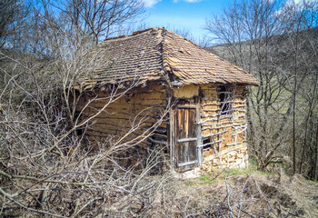 Old shed in abandoned mountain village in south Serbia, travel and tourism concept