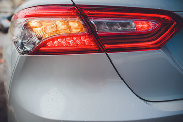 taillight back light with brilliant reflections auto white body