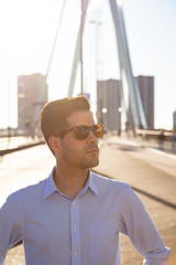 Confident man in urban setting with sunglasses