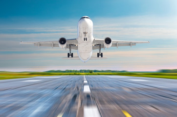 Passenger airplane landing on a runway airport.