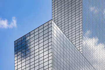 Glass office building and cloudy sky