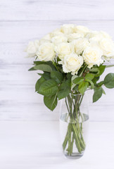 Bouquet of white roses in a vase. Bouquet of chic white roses