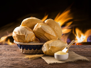 """Basket of """"French bread"""", traditional Brazilian bread with fire background."""