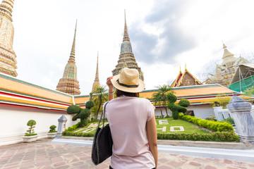 Asian beautiful tourist women travel in the buddha temple in Bangkok Thailand