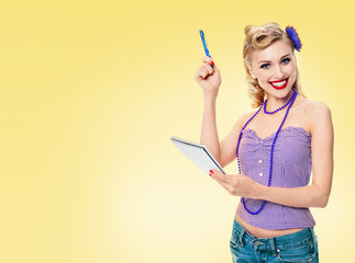 Woman with notepad, in pinup style clothing