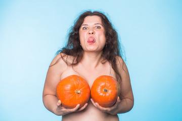 Plastic surgery concept - woman breast pumpkins implant upsize metaphor