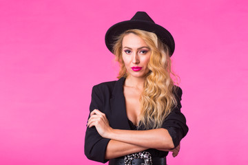 Luxury, style and people concept - beautiful sexy woman in a black hat with pink lips and a stylish clothes