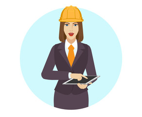 Businesswoman in construction helmet using a digital tablet PC