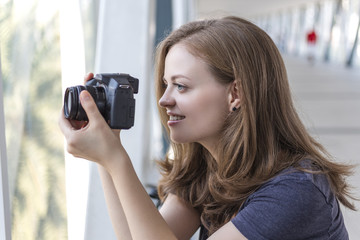 Young caucasian woman taking pictures with camera