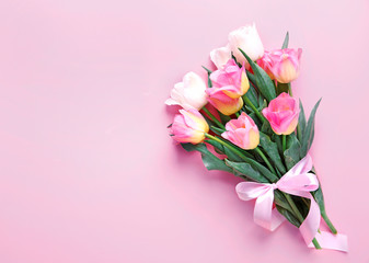 Pink tulips bouquet on empty space background.