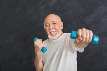 Senior man making exercise with dumbbells