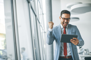 Young businessman with digital tablet in office