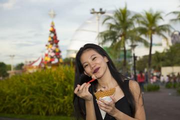 Filipina Enjoying Ice Creat at the Amusement Park